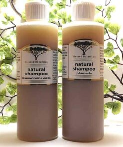 Blessed Botanicals Natural Shampoo Frankincense & Myrrh Bottle Next To Plumeria Bottle