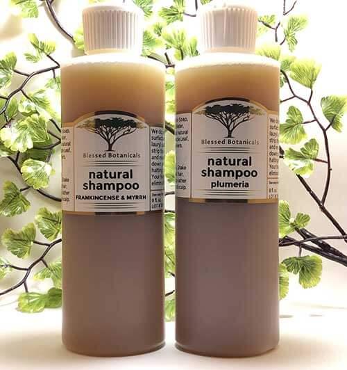 Blessed Botanicals Natural Shampoo Frankincense & Myrrh Bottle Next To Plumeria Bottle